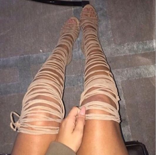 Black or tan thigh high lace up heel boots