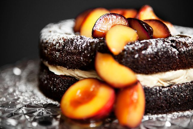 Chocolate Cake with Salted Caramel Frosting and Poached Plums
