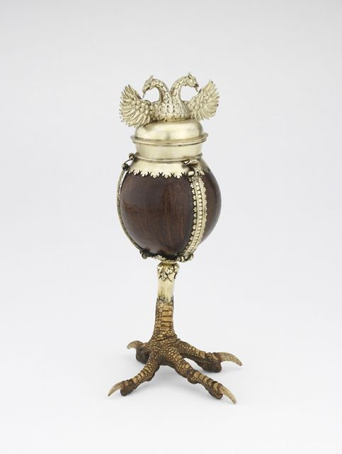 Coconut cup and cover, Northern Netherlands, c. 1540 - 1560, coconut, eagle-claw, silver-gilt. Height 27 cm. Bequeathed by Michael Wellby, 2012 © Ashmolean Museum, University of Oxford