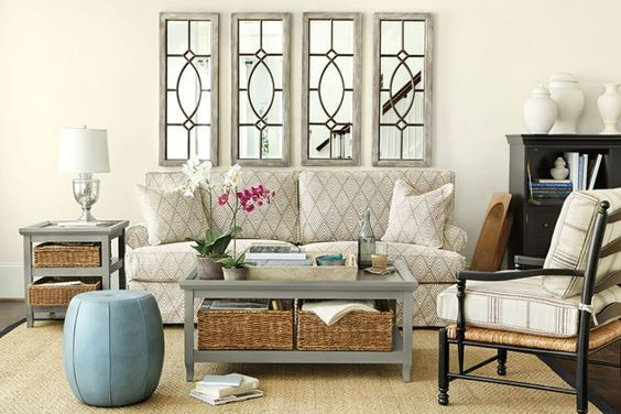 Hang a set of mirrors over your sofa