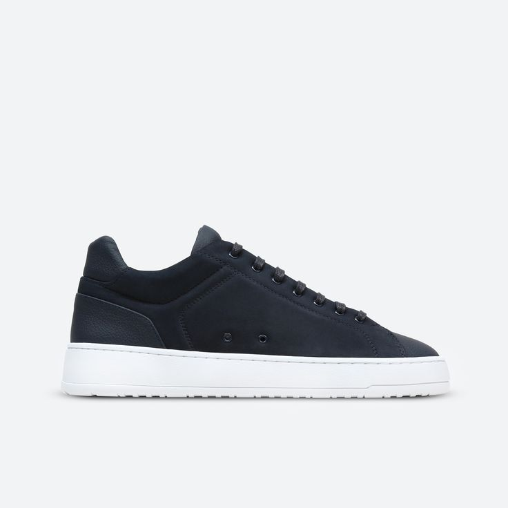Low-top nubuck leather sneaker in Midnight. Features a tonal leather trim, lace-up closure, eyelets and a white rubber cup sole unit. Full calf leather lining and insole. Comes in a branded box with a spare set of waxed laces.