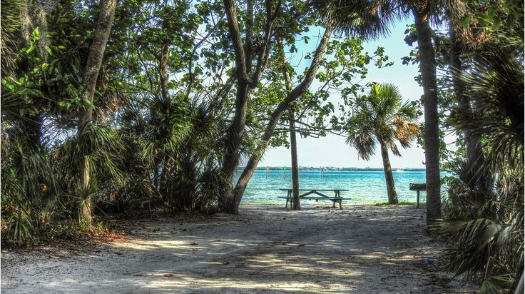 Fort De Soto County Park straddles five interconnected islands and 1,136 acres off the coast of St Petersburg where Tampa Bay meets the Gulf. Mangroves, hardwoods, palm hammocks, and wetlands set a lush scene for outdoor fun on the water. The park boasts