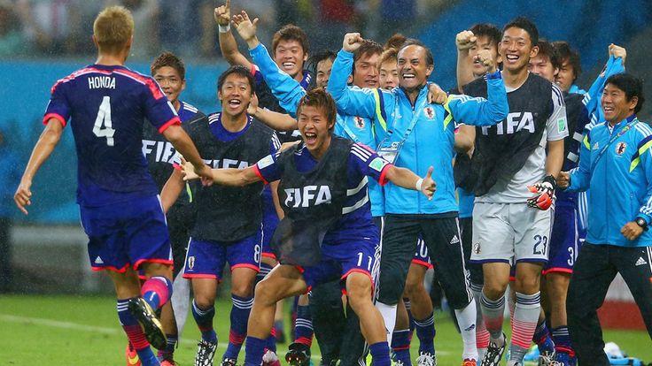 Keisuke Honda of Japan (L) celebrates scoring the team's first goal