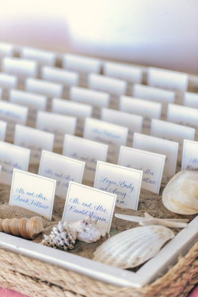 Beach escort cards with shells and sand