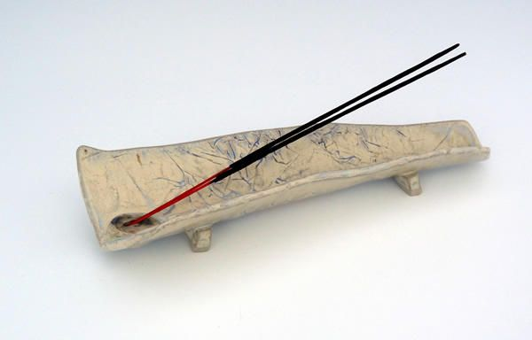 Incense Stick Burner This piece is burner has long groove shape to successfully catch all of the ash. It is decorated with texture, glaze, oxides and glass and is inspired by the Irish landscape. http://www.marketdirect.ie/incense-stick-burner