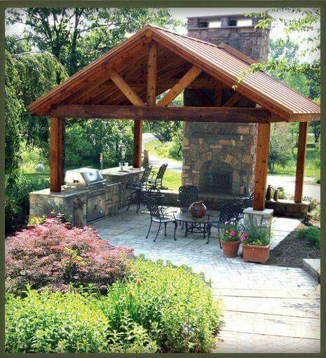 outdoor fireplace and kitchen under pergola | Gre…