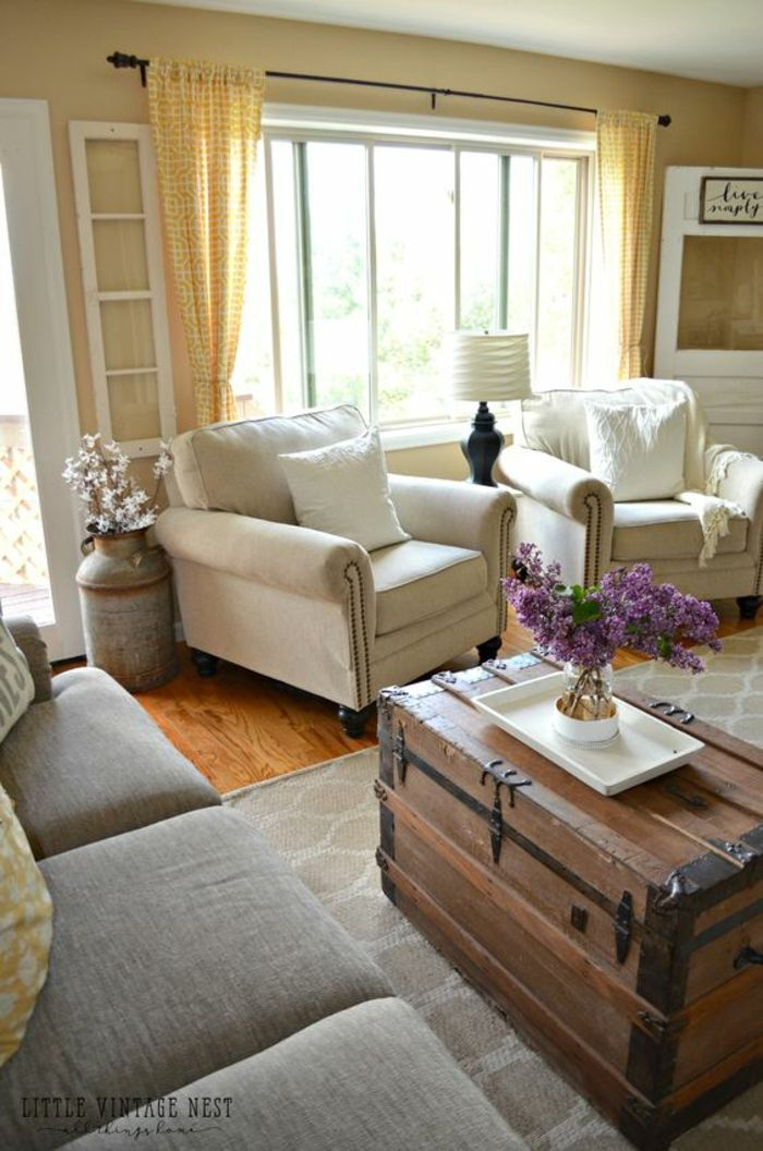 Living Room Paint Cream Chair Part - 13: living room paint colors, pale yellow walls and curtains, light grey sofa  and two cream colored chairs with pillows, big wooden chest used as table,  ...