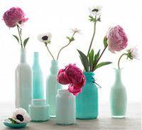 Floreros hechos con botellas viejas