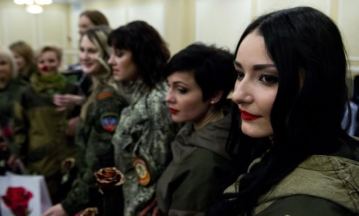Women operating in combat battalions of the self-proclaimed People Republic of Donetsk pose for photographers in Donetsk on March 7, 2015.