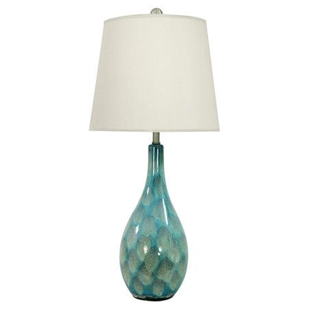 Cast a warm glow in your living room or home library with this classic ceramic table lamp, showcasing a blue and green finish for visual appeal....