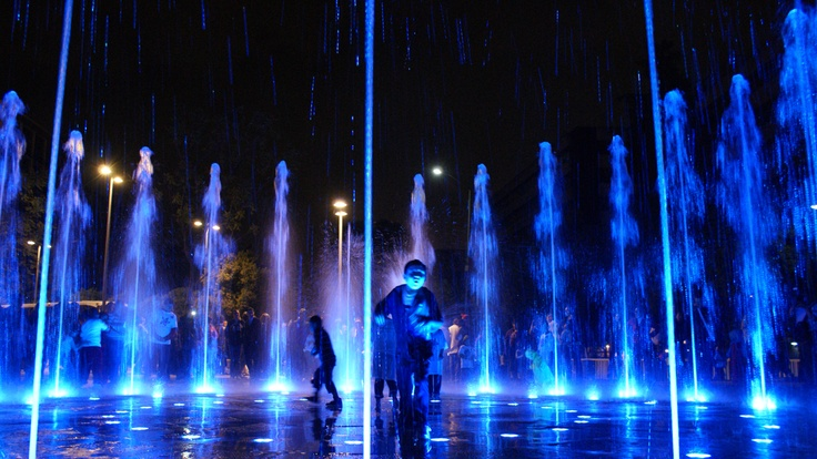 children playing in the water fountains