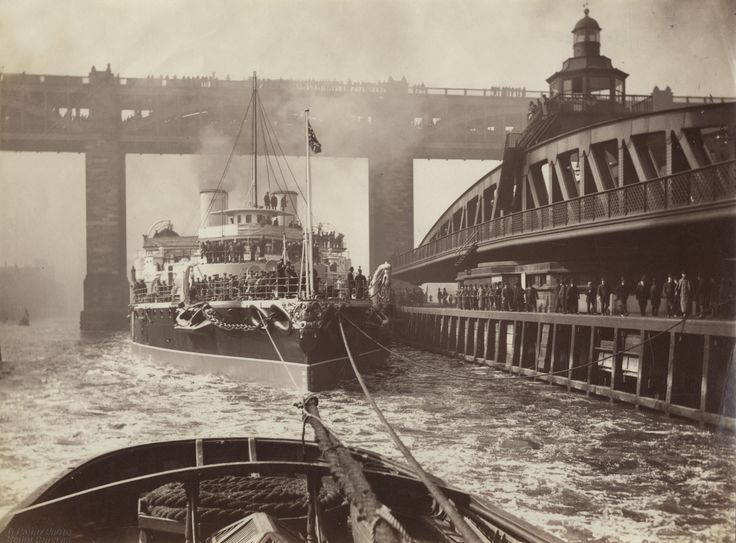 """""""HMS Victoria passing swing bridge while en route from Armstrong Shipyard at Elswick"""". Newcastle-upon-Tyne. c. 1890."""