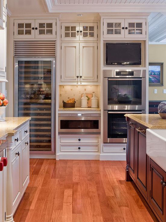 i'm drawn to this kitchen because of the modern appliances. The see through fridge makes the kitchen look very new and innovative.