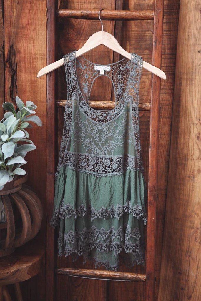 Ruffle Sheer Embroidered Woven Top Open-back. Be daring with a lace bralette or wear with an under tank. 65% COTTON, 35% NYLON COLOR: OLIVE