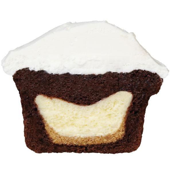 How to add a mini cheesecake to the center of a cupcake. This is a great combination with cupcake flavors such as chocolate, orange, peanut butter and strawberry.