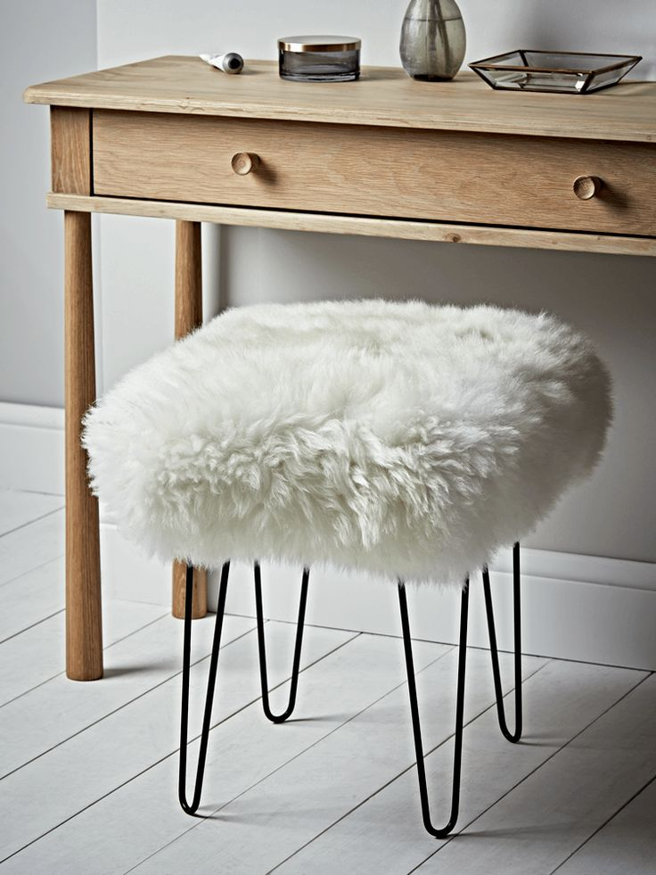 Carefully handmade in the UK, our sheepskin dressing table stool seat cover is crafted from 100% natural long haired sheepskin in a soft ivory colour. Rectangular in shape, with four black iron hairpin legs to give an industrial twist, this sumptuous stool has an upholstered, padded seat with removable sheepskin. A brush is included for cleaning. Pair with our Bergen Oak Dressing Table to complete a Scandi industrial look.