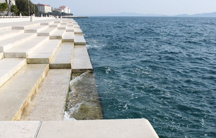 Architecture used as an instrument: incredible 'Sea Organ' uses ocean waves to make beautiful music. Croatian architect Nikola Bašić created an incredible nature-based instrument, the Sea Organ, a set of 35 organ pipes installed marble jetty that make beautiful music as waves lap at the coastline.