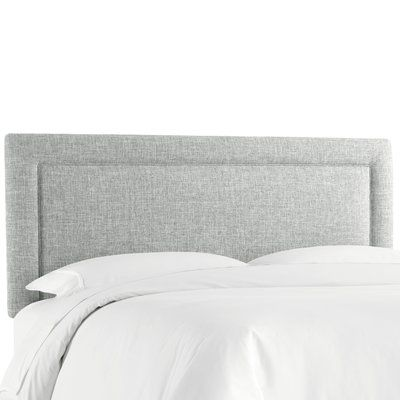 This transitional headboard with its clean lines and subtle stitching detail will bring a decorator look to your special retreat. It conveniently attaches to a standard metal bed frame.