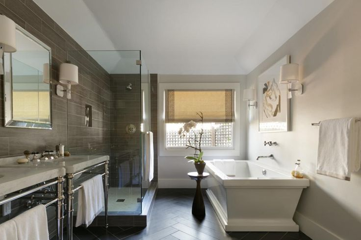Soaking tubs also come in classic styles, making them at home in traditional design. This master bathroom designed by Ann Lowengart boasts a full range of modern features while maintaining a timeless appeal.