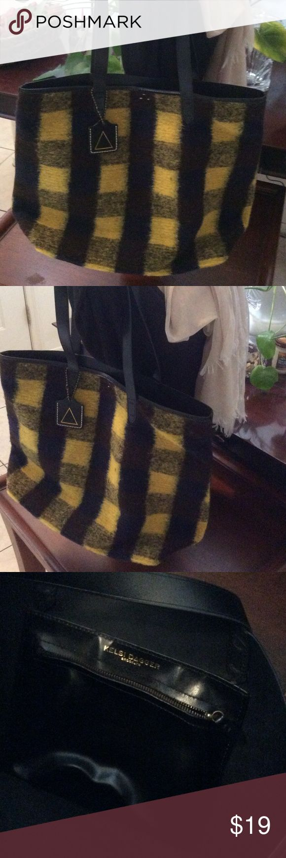 """Kelsi Dagger large tote black leather and plaid Kelsi Dagger large tote black leather and black watch plaid in yellow. Condition is very good. 20"""" x 18"""" x 3"""" Kelsi Dagger Bags Totes"""