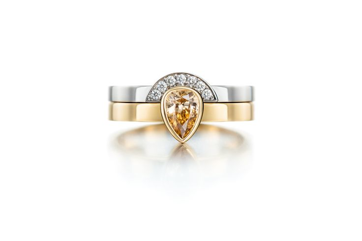 Custom-made wedding ring from 750 yellow gold with pear shape 0.41ct light brown/ shampagne colored diamond. Design Heidi Vornan Photo Mikael Pettersson