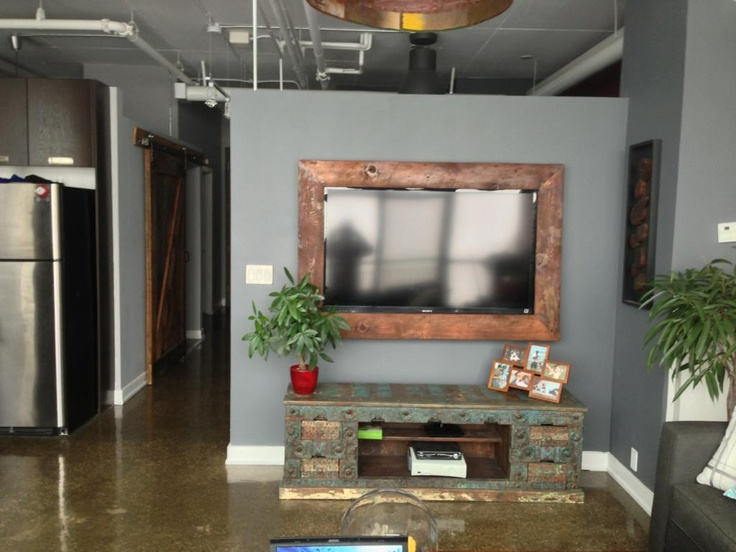 TV framed in reclaimed wood by Forever Interiors