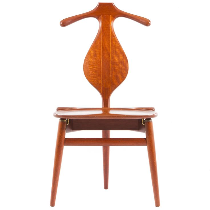 Hans Wegner Valet Chair. Denmark  1953  Iconic,sculptural and functional designed chair from Hans Wegner and manufactured by Johannes Hansen of Denamrk. Oak chair with teak seat. Stamped to underside of chair with branded mark. Teak, oak and brass
