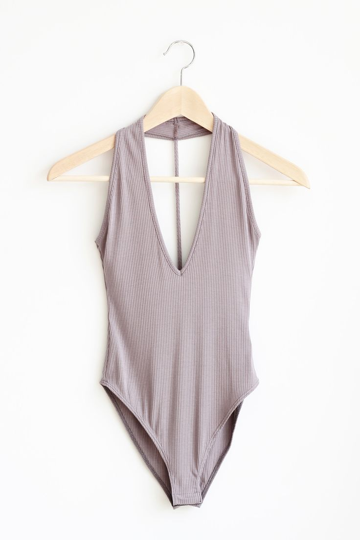 "- Details - Size - Shipping - • 94% Rayon 6% Spandex • Rib halter bodysuit with button snap closure. • Hand Wash • Line dry • Made in USA • Measured from small • Length 25.5"" • Chest 14"" • Waist 13"" -"