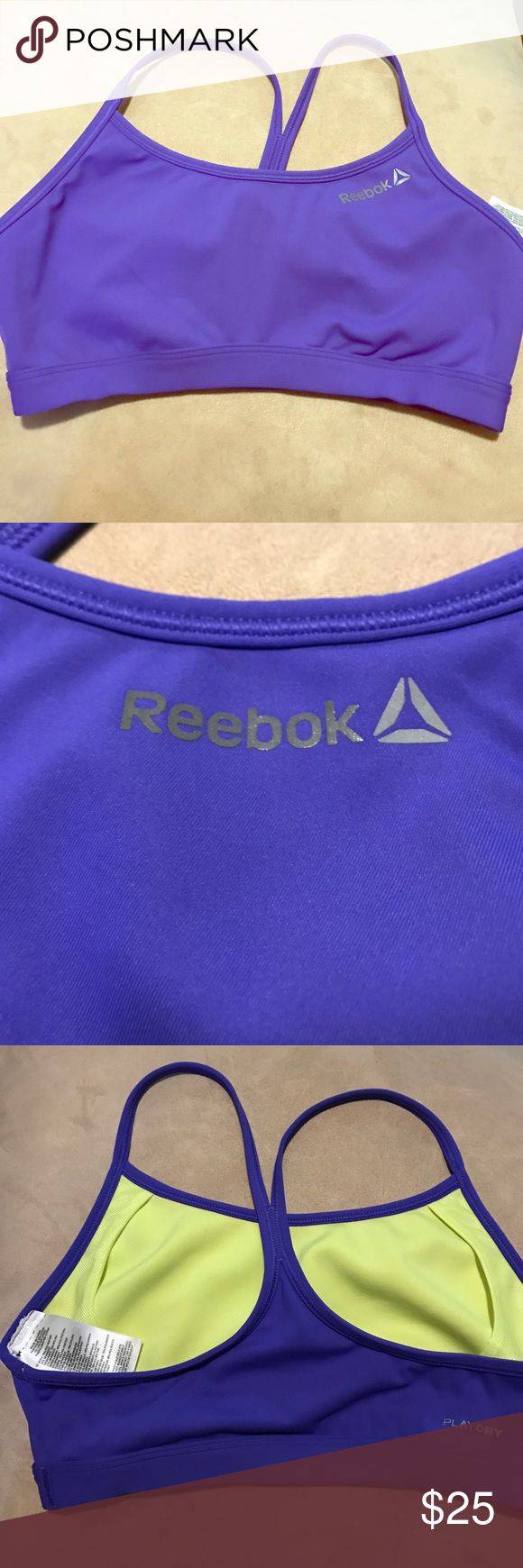 Reebok crossfit sport bra, volleyball or swim top Reebok play dry material bright purply cobalt blue racerback bra top - great for swim, triathlon, volleyball, crossfit or gym with quick drying yellow mesh liner.  Ordered online and was not the right size.  True reebok size small. Reebok Tops Crop Tops