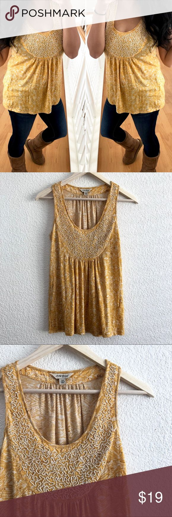 """Lucky Brand Beaded Sleeveless Blouse - Yellow Pit to pit: 16"""" Top to bottom: 26""""  Sleeveless blouse with pearl-white beaded collar design. All beads in-tacked and in great condition!   Honey mustard color with splashes of white and a darker, almost brown color.   Diamond design.   Size says XS but fits me just fine and I usually wear a size medium. I think it's more of a loose-fitting top. Lucky Brand Tops Blouses"""