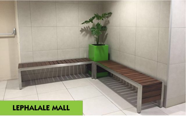 Custom manufactured Mall benches and Green Square planters.