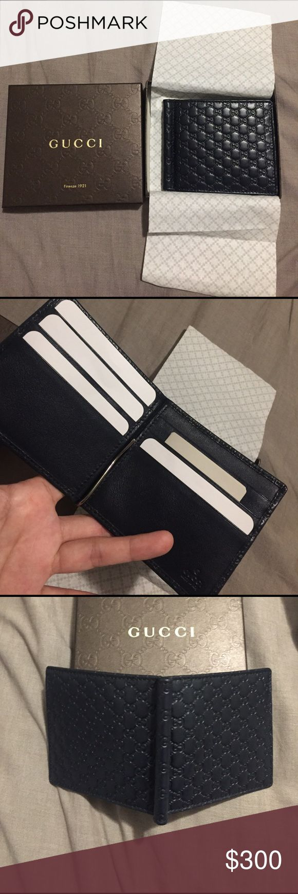 NWT GUCCI Men money clip wallet navy Brand new with box Gucci classic money clip wallet, micro guccissima leather, navy color, both wallet & box made in ITALY. great birthday gift Gucci Accessories Money Clips
