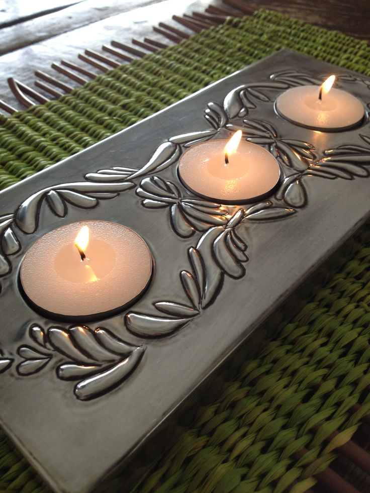 Pewter embossed tea light holder