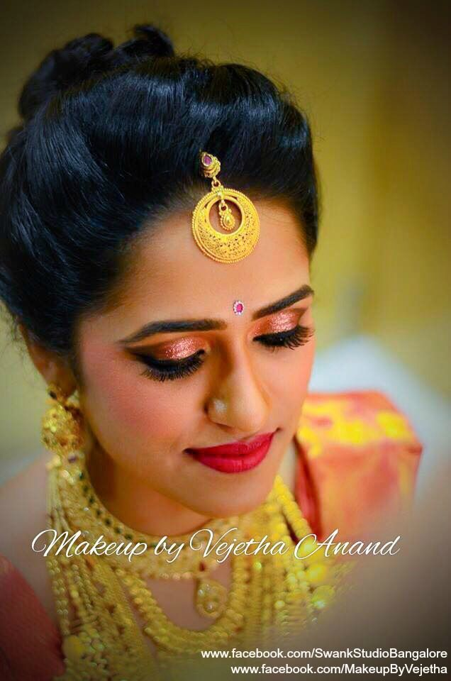 Our bride Bhavya looks like a diva for her reception ceremony. Makeup and hairstyle by Vejetha for Swank Studio. PHOTO CREDIT: Manish Ananda. Traditional Southern Indian bride. Bridal hairstyle. Bridal jewellery. Glitter eye makeup. Red lips. Maang Tikka. Silk sari. Tamil bride. Telugu bride. Kannada bride. Hindu bride. Malayalee bride. Bridal Saree Blouse Design. Indian Bridal Makeup. Indian Bride. Gold Jewellery. Statement Blouse.  Find us at https://www.facebook.com/SwankStudioBangalore