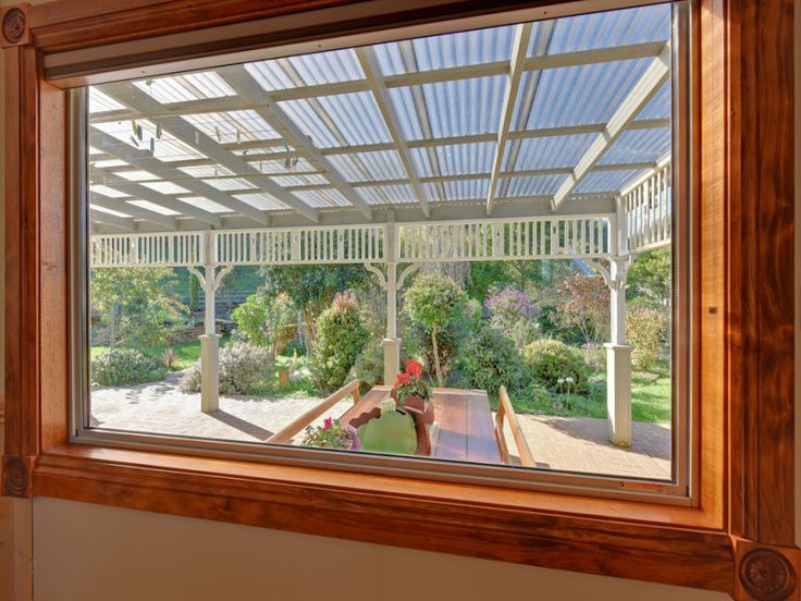 Nicely framed view to the covered al fresco area with lovely planting behind - most inviting: 78 West Ridgley Road, Ridgley, Tas 7321