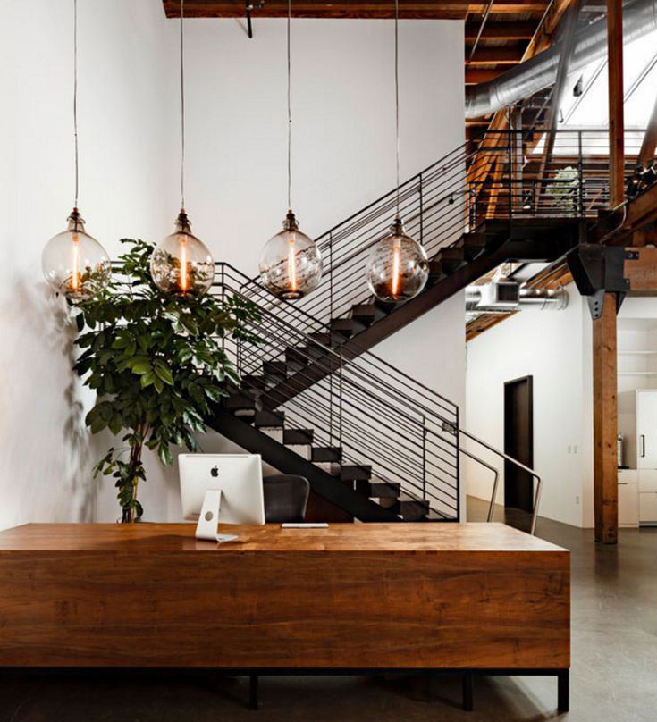 This Portland office has a gorgeous large reception with industrial bulb pendant lighting above.