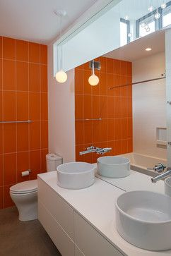 orange tile; pendant lighting in front of clerestory window; frameless mirror