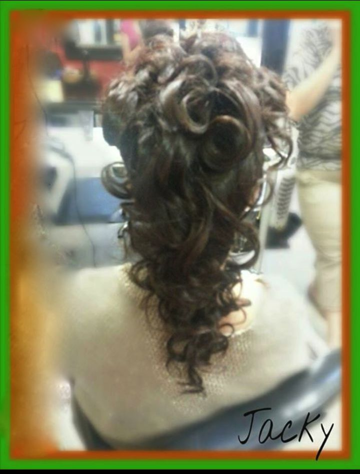 curly hair, pulled up by jacky