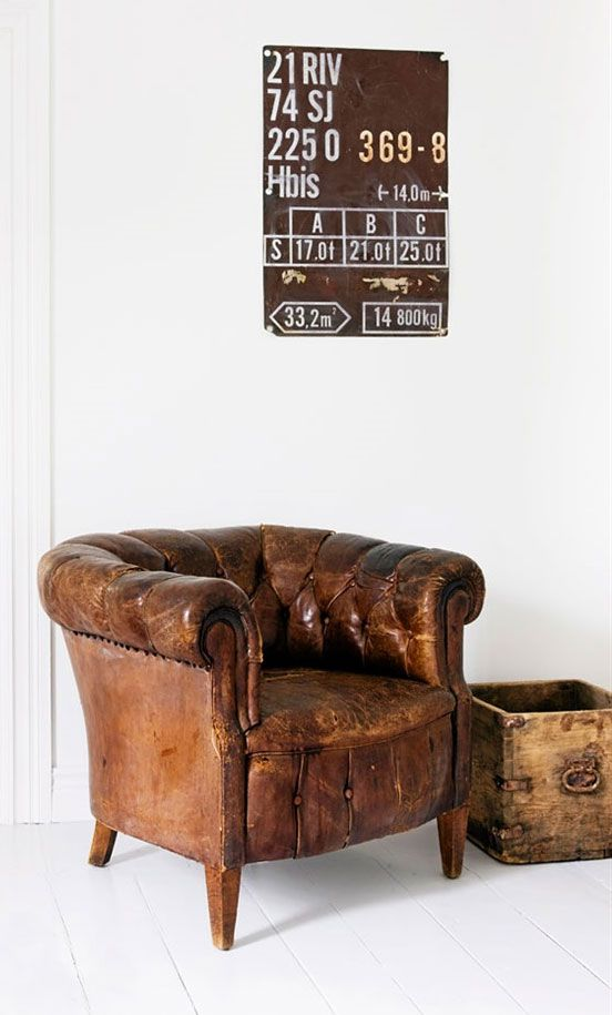 love the distressed leather chair