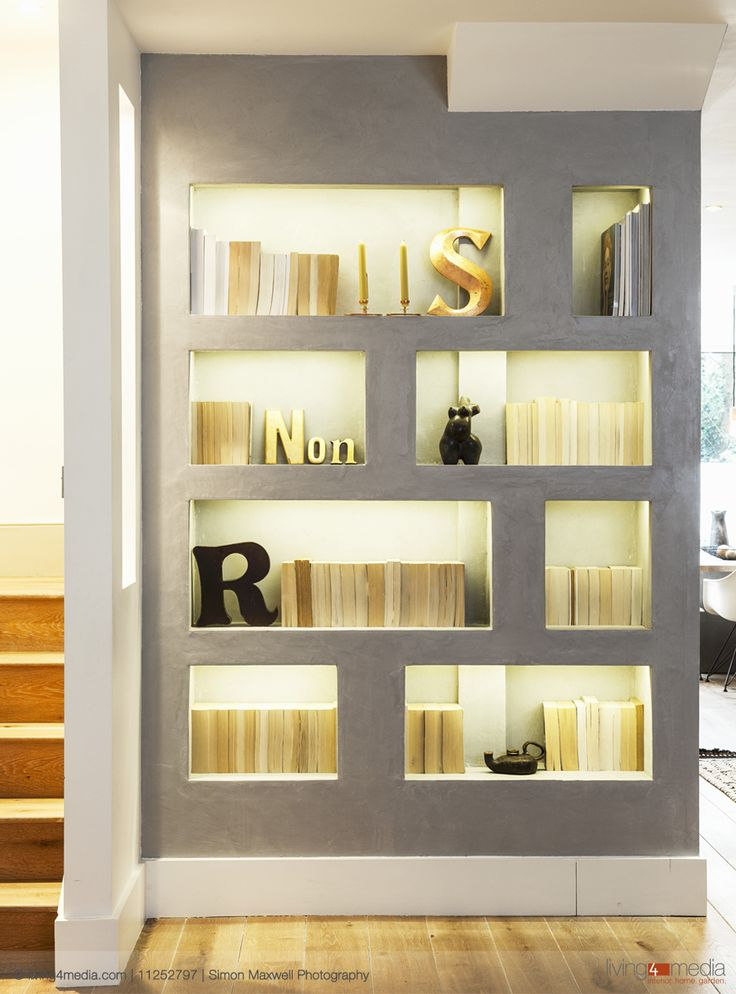 Modern grey wall with backlit shelving niches and for Modern furniture decor