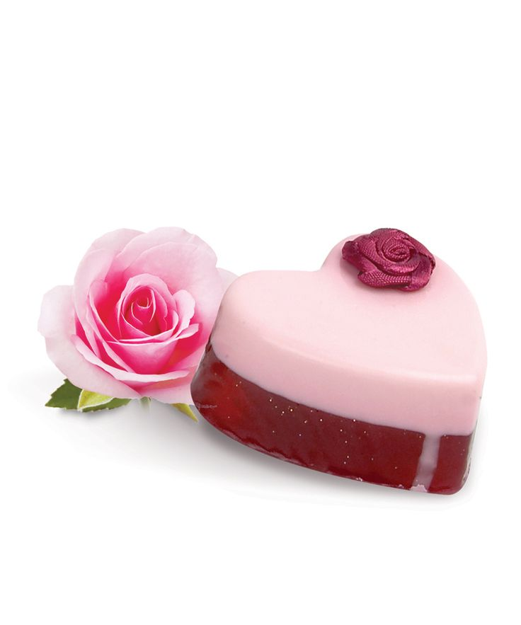 Rosegarden #Soap #heart  A two-layered soap heart with a #pink glitter base soap topped with a spotless white soap, finished by a lovely pink rose.  This lovely soap is  enriched with a fresh green rose scent with subtle fruity notes. A modern interpretation of a classical rose fragrance with a floral heart.