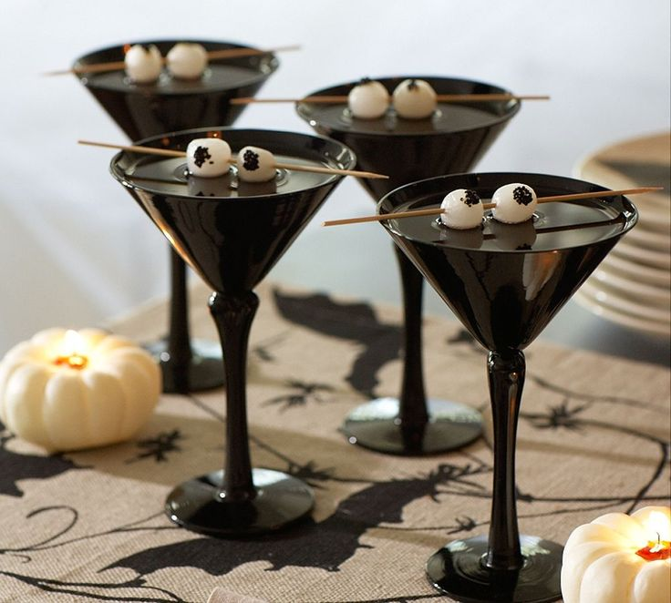 Martinis with eyes. You could use olives or lychees / halloween party cocktail recipes