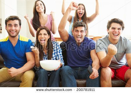 Group of Friends Watching Soccer Celebrating Goal - stock photo