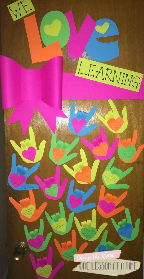 We love learning: Each student create a hand that shows the sign for I Love You and fill out something they love. http://hative.com/creative-valentines-day-bulletin-board-ideas/