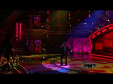 Adam Lambert during American Idol's Top 9 Popular iTunes Download Week performing Wild Cherry's 'Play That Funky Music'