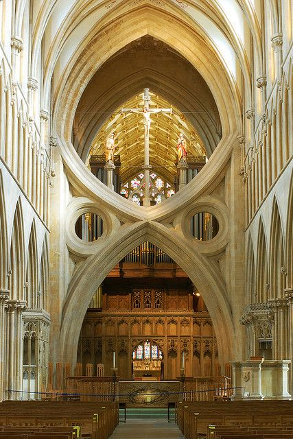 scissor arches of Wells Cathedral.    During the 14th century the central supports of the crossing (the junction of a Cathedral's four arms) were found to be sinking.  In 1338 Bishop Ralph of Salisbury decided to build internal scissor arches to support the weight.