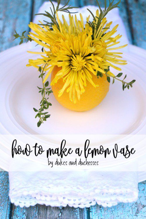 Create a simple lemon vase filled with grocery store flowers for a gorgeous pop of color at each place setting!