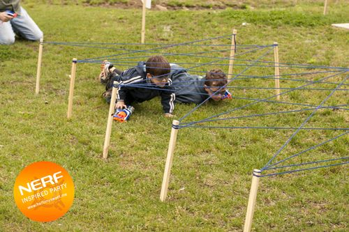 Fun outdoor party ideas for boys, make an obstacle course. This one uses wooden stakes and yarn, simple and easy!