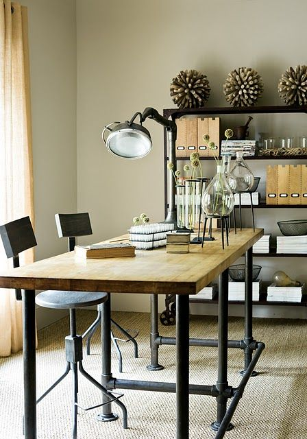 Cool idea -- pipes painted make an inexpensive base for a tabletop