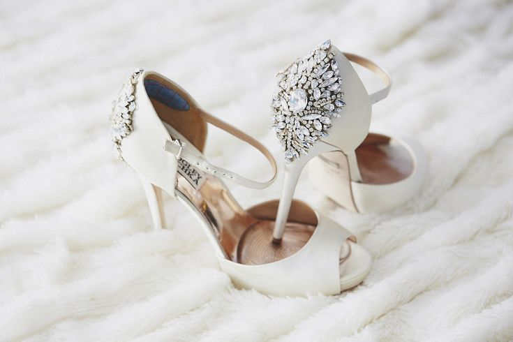 Brittney Palmer accessorized her bridal look with white peep-toe pumps that featured an intricate crystal embellishment on each heel. Photography: Daniel Kincaid Photography. Read More: http://www.insideweddings.com/weddings/brittney-palmer-and-aaron-zalewski/595/